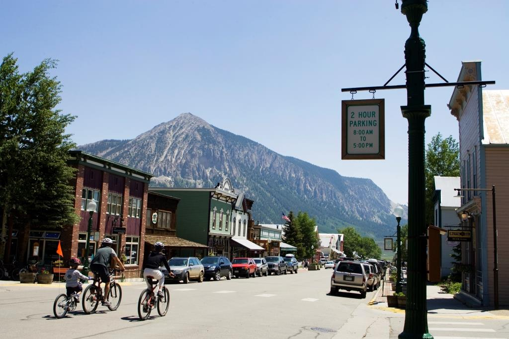 A family bike ride though downtown Crested Butte