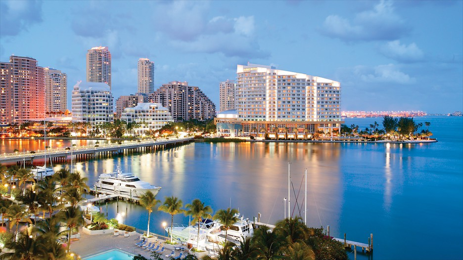 Speed boats travel through Government Cut near Fisher Island and Miami Beach.