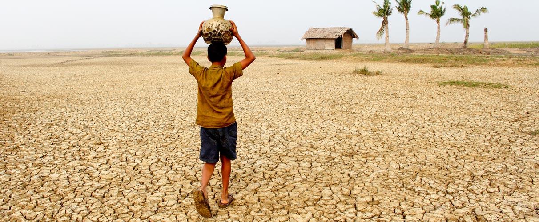 Mithun mondal carrying water in Koira, sathkhira, bangladesh