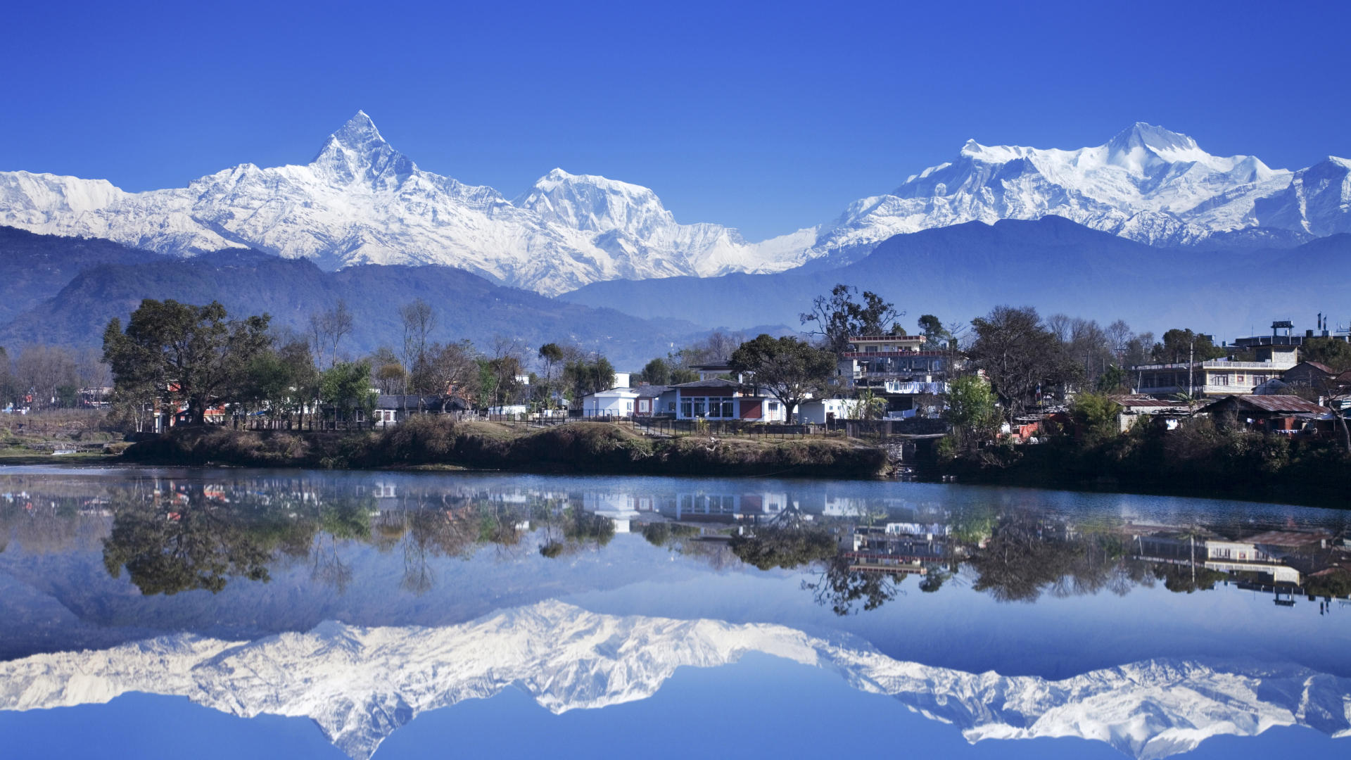 Reflection of mountains in a lake, Fewa Lake, Pokhara, Nepal