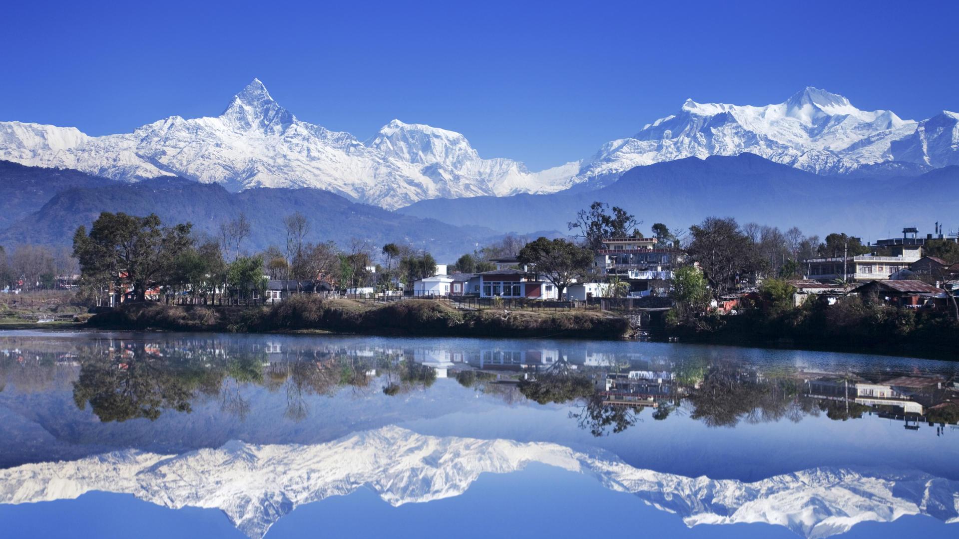 Reflection of mountains in a lake, Fewa Lake, Pokhara, Nepal